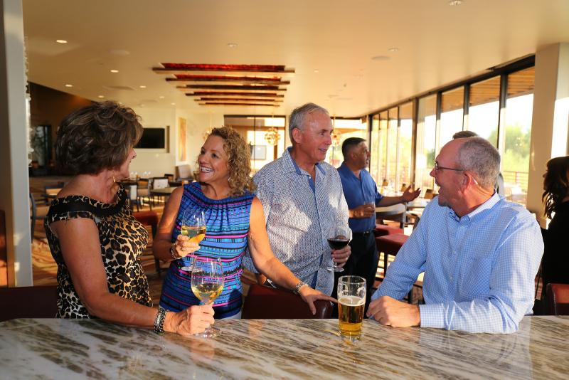 Members celebrating at the bar
